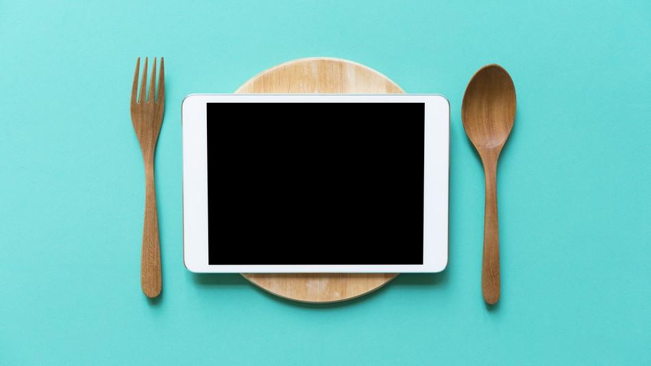 Comida servida em iPads!