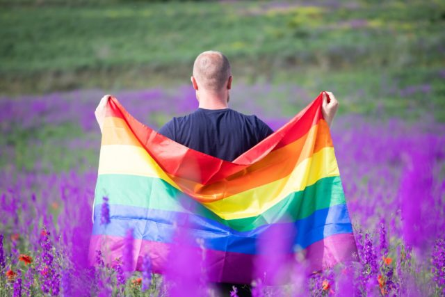 Young man with LGBT flag.