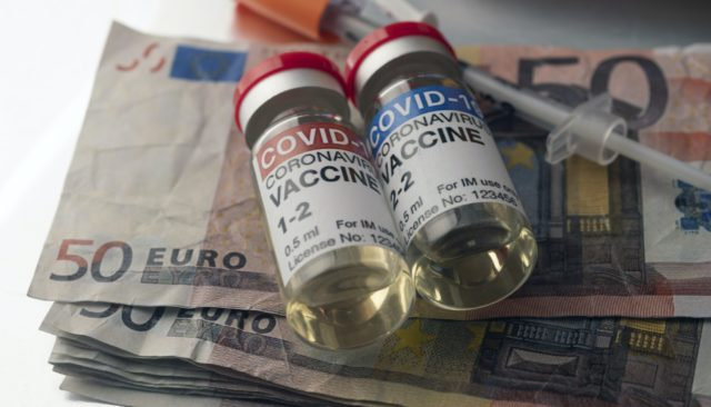 Covid-19 coronavirus vaccine for vaccination plan together with banknotes